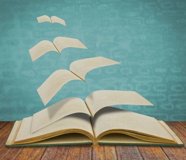 abierto-volando-libros-antiguos_1232-2096